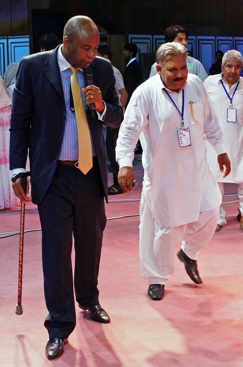 This man could not walk without stick. After the prayer he can walk by himself!